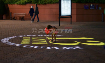 Projection of logos on floors and sidewalks